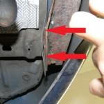 Verbogenes Heckblech hinter Stoßfänger Ford Fiesta